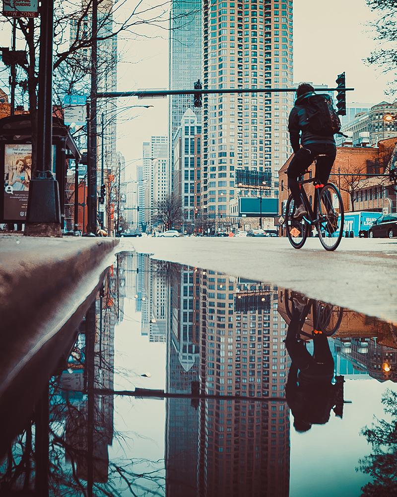 person riding a bike down a street